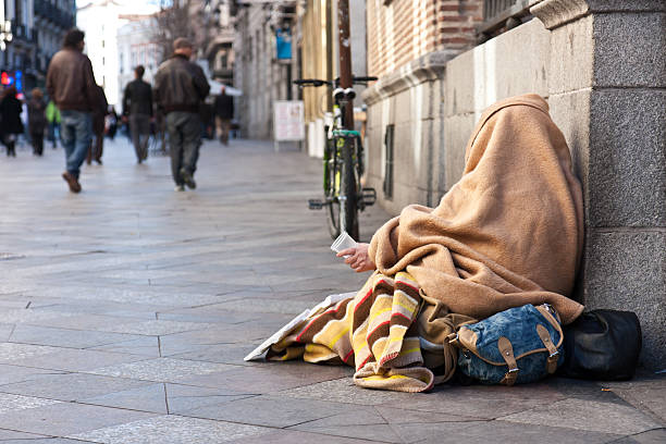 Beggar in the street stock photo