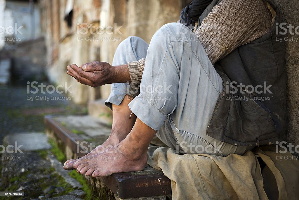 Beggar is begging for food on the street stock photo