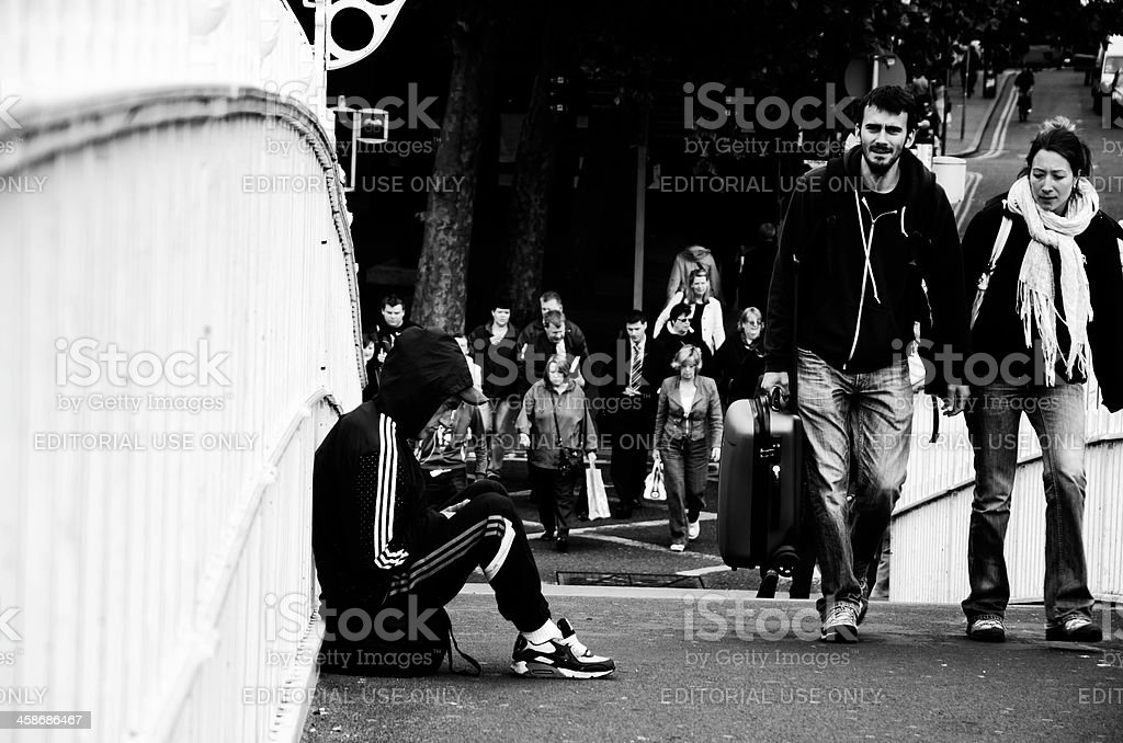 Beggar on the Dublin Bridge stock photo
