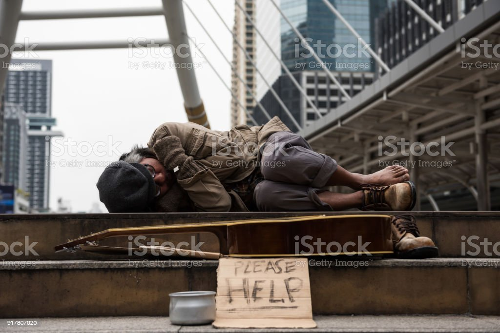 beggar or Homeless man sleep in city at winter stock photo