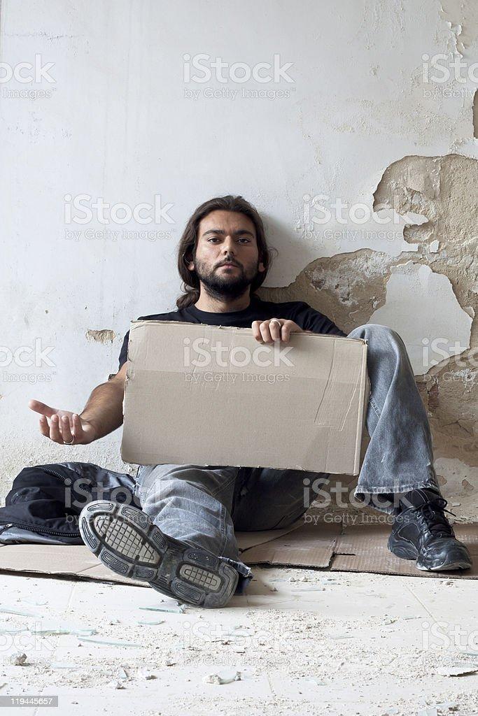 Beggar with Cardboard royalty-free stock photo