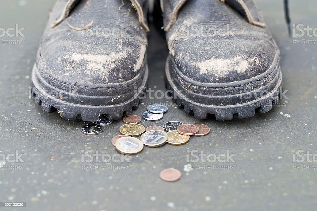Begger And Coins stock photo
