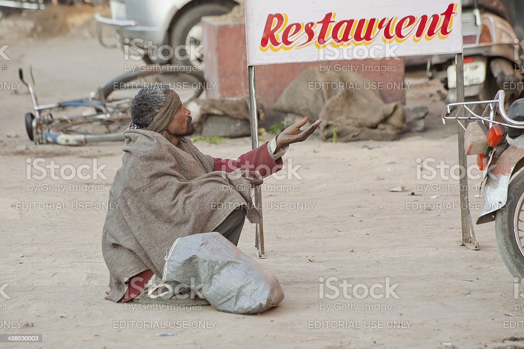 begger is begging at street of jaipur india stock photo