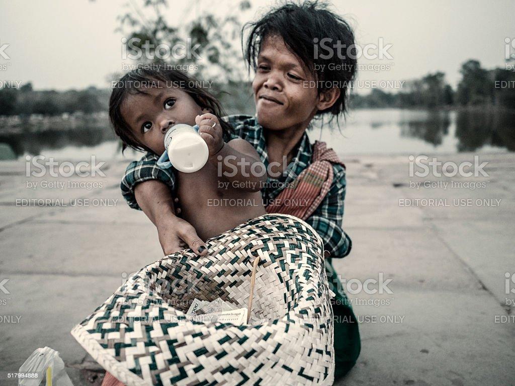 Begging at Angkor Wat Cambodia stock photo