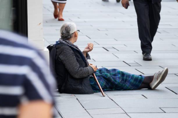 Begging In Shopping Street stock photo