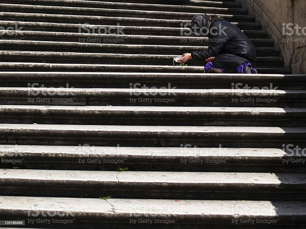 Begging on steps 2 royalty-free stock photo