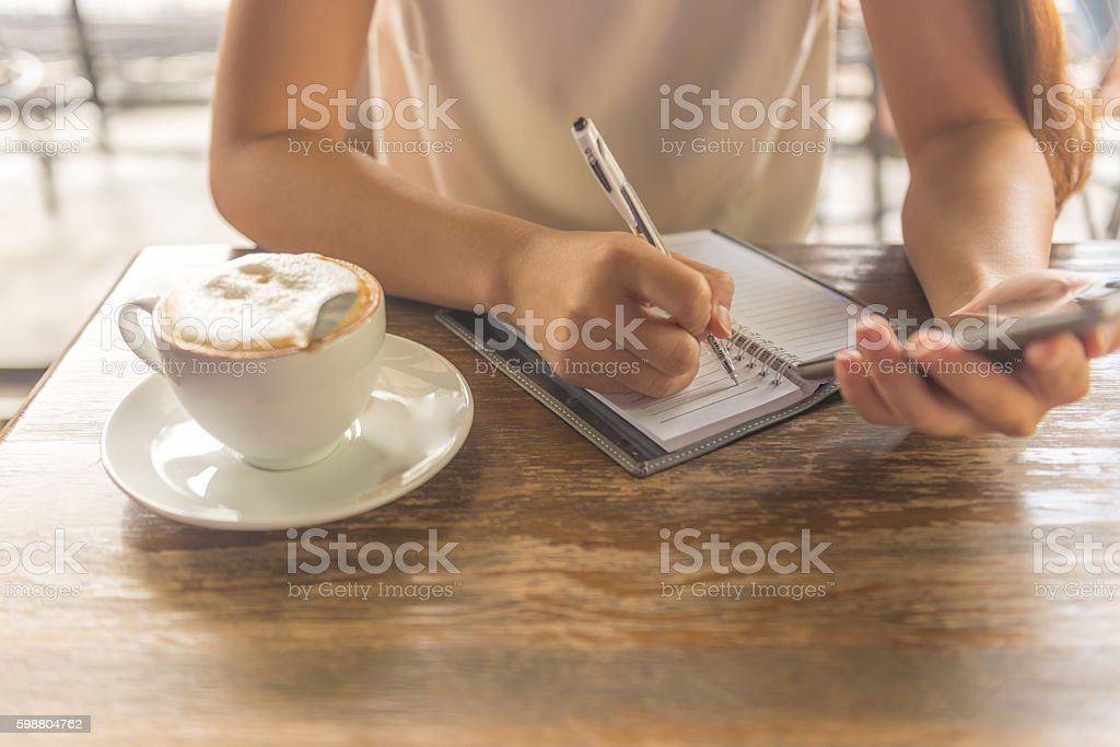 Begin new working day with hot cappuccino and to-do list stock photo