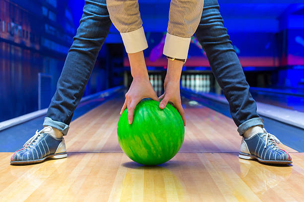 Beginner aiming to bowling pins stock photo