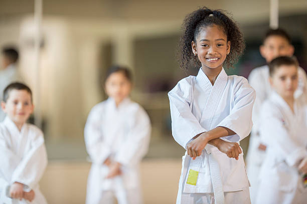 beginning a karate class - karate stock photos and pictures