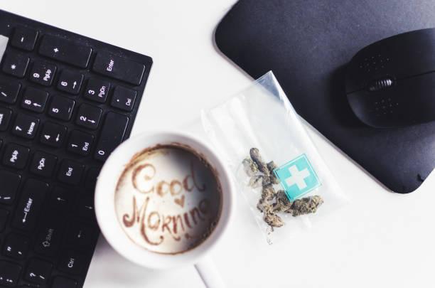 Beginning morning with coffee and marijuana stock photo
