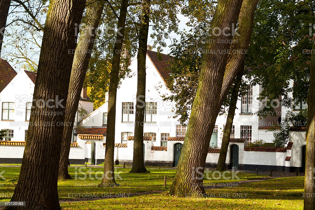 Beguines courtyard and homes in Bruge stock photo