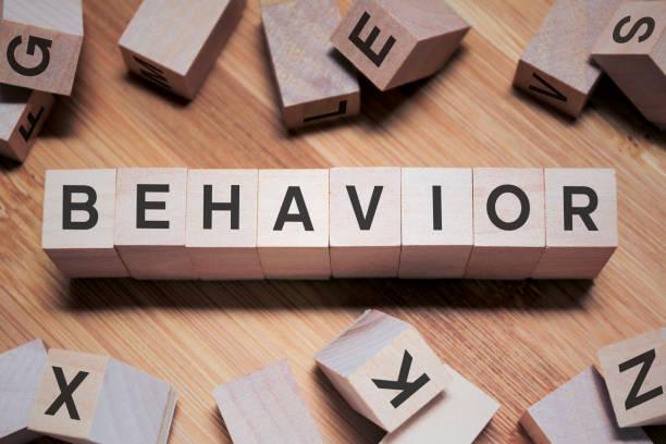 Behavior Word In Wooden Cube stock photo