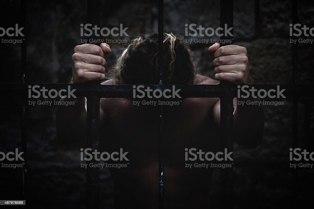 Behind bars stock photo
