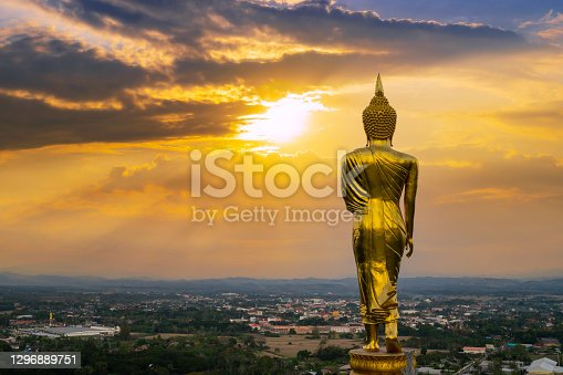 istock behind Buddha statue before sunset time at Wat Phra That Kao Noi Nan, Thailand 1296889751