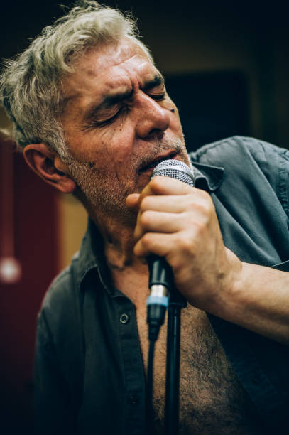 behind scene. famous alternative male singer practice singing on microphone - punk music stock photos and pictures