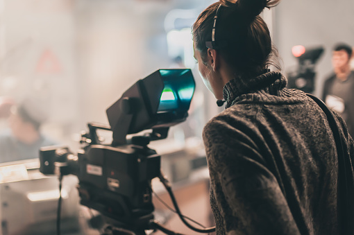 Behind scene. Multiple camera. Cameraman shooting film scene with camera