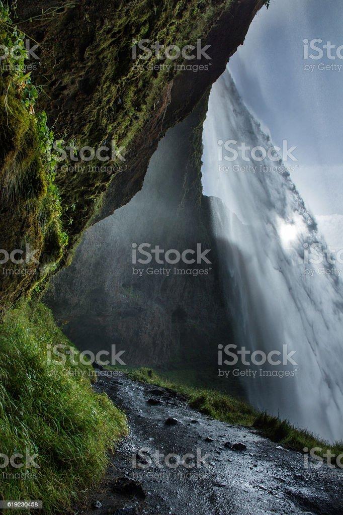 Behind Seljalandsfoss, Iceland stock photo
