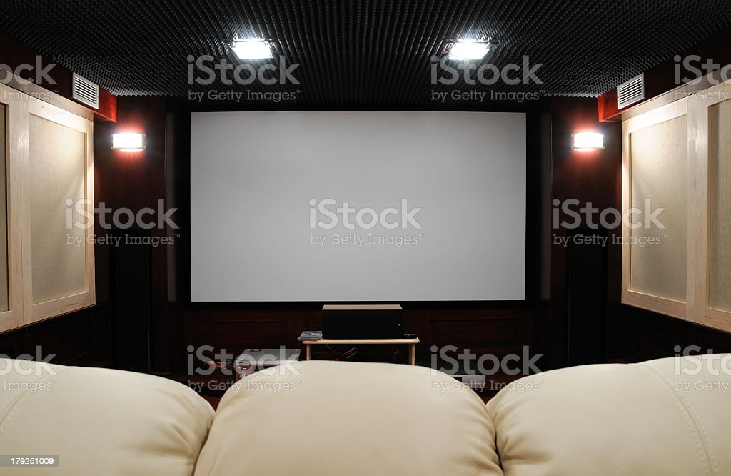 Behind the couch point of view of home theater setting stock photo