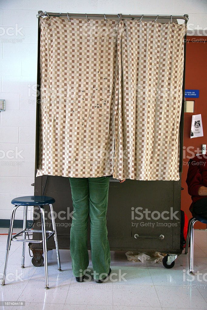 Behind The Curtain of a Voting Booth stock photo