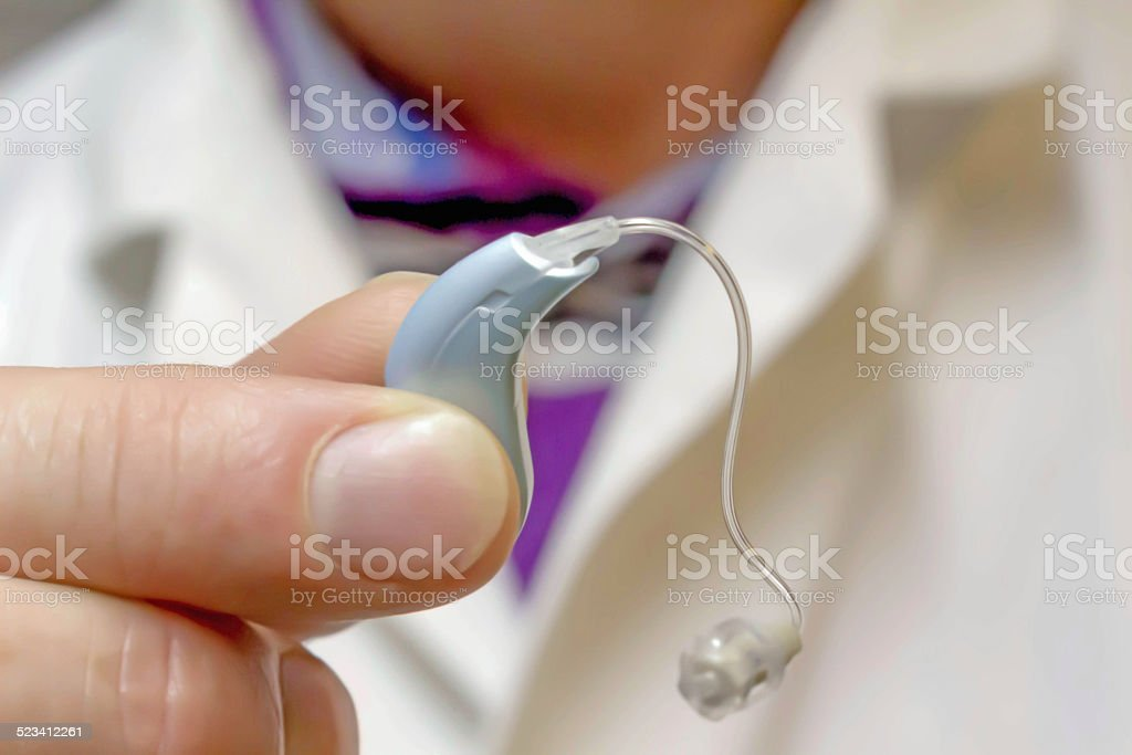 Behind the ear hearing aid stock photo