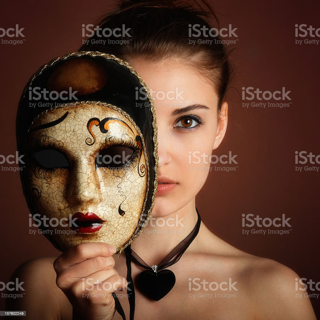 behind the mask stock photo