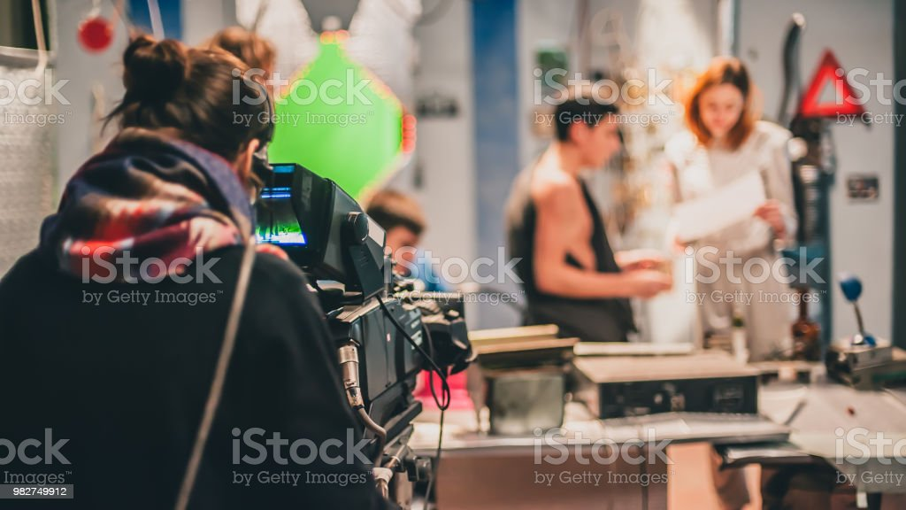 Behind the scene. Actor in front of the camera on the film set in...