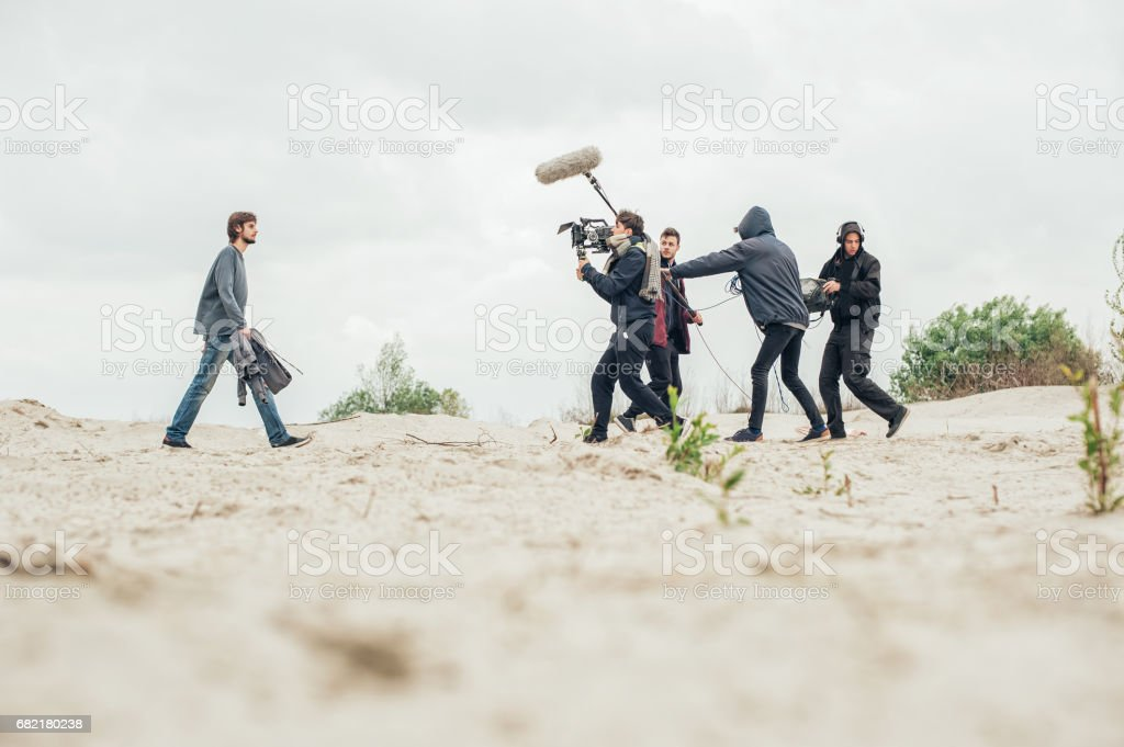 Behind the scene. Film crew filming movie scene outdoor stock photo