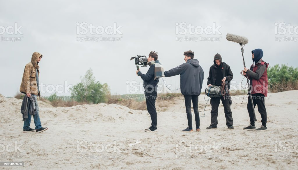 Behind the scene. Film crew filming movie scene outdoor foto stock royalty-free