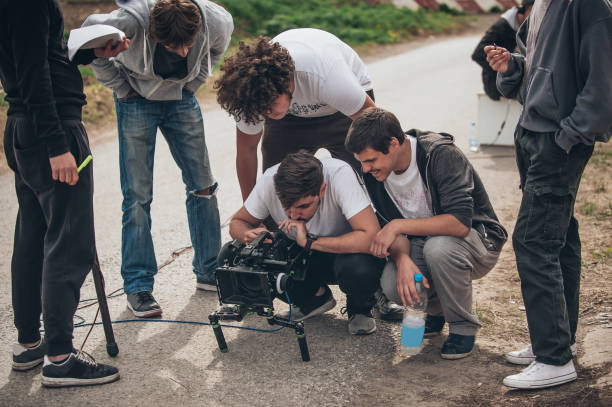 behind the scene. film crew filming movie scene outdoor - sport set competition round stock photos and pictures