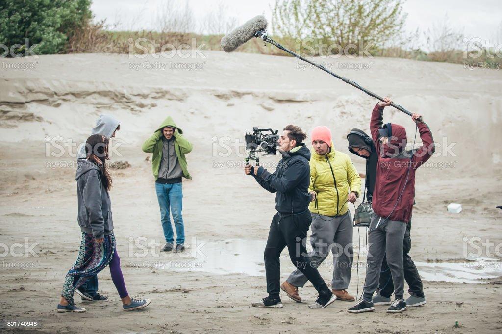 Behind the scene. Film crew filming movie scene outdoor stock photo
