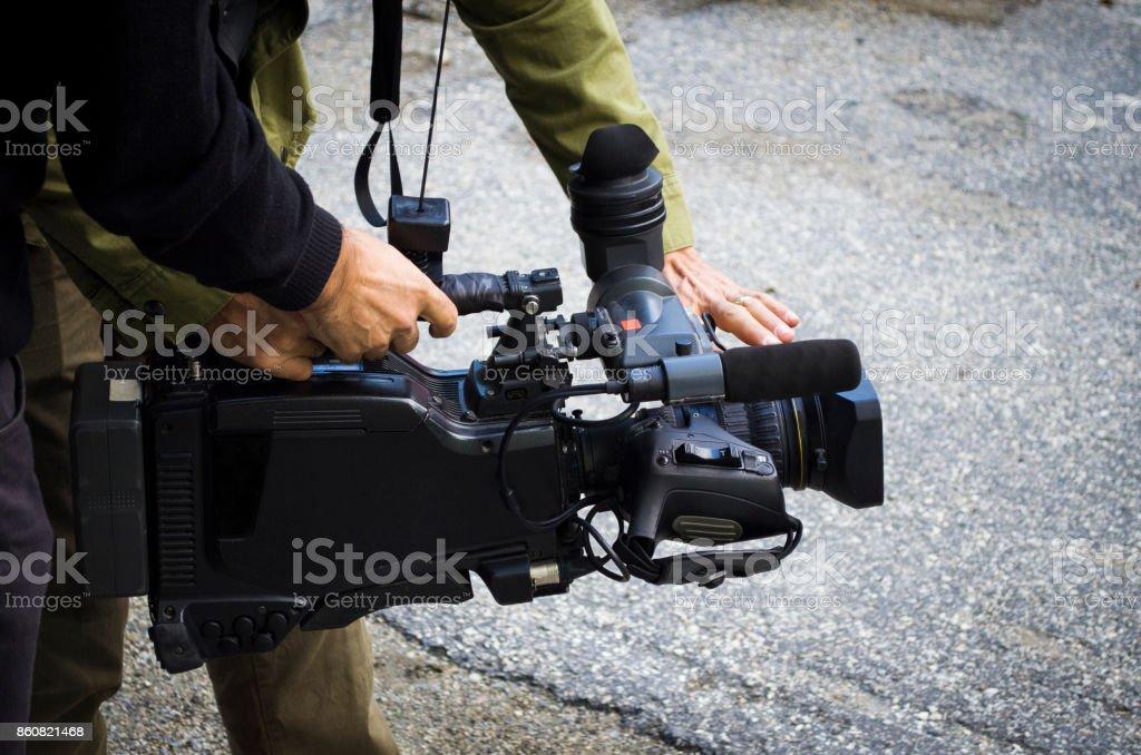 behind the scene film crew team filming movie scene on outdoor location group cinema set stock photo