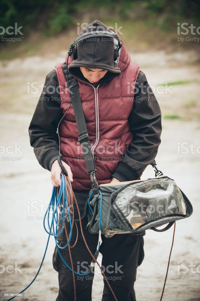 Behind the scene. Sound technician check equipment before recording royalty-free stock photo