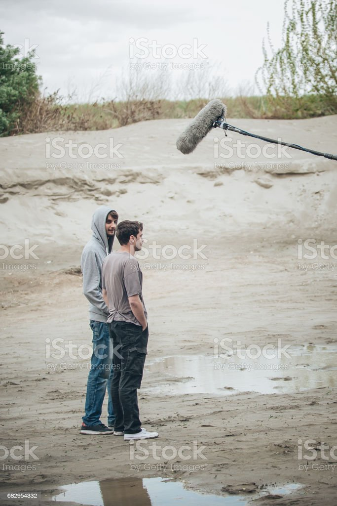 Behind the scene. Two actors in front of boom microphone royalty-free stock photo