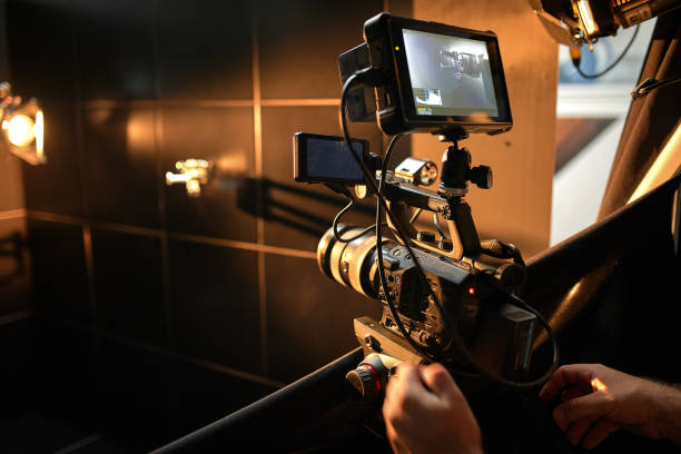 Behind the scenes of filming movies and video products, setting up equipment for shooting video and sound. The concept of producing video content for social networks, TV and blogs stock photo