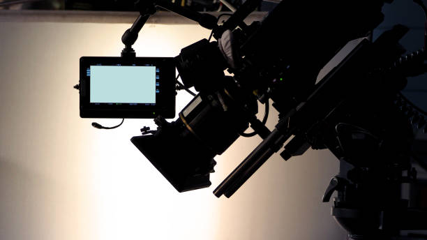 Behind the scenes of video production and movie crew team working in silhouette stock photo