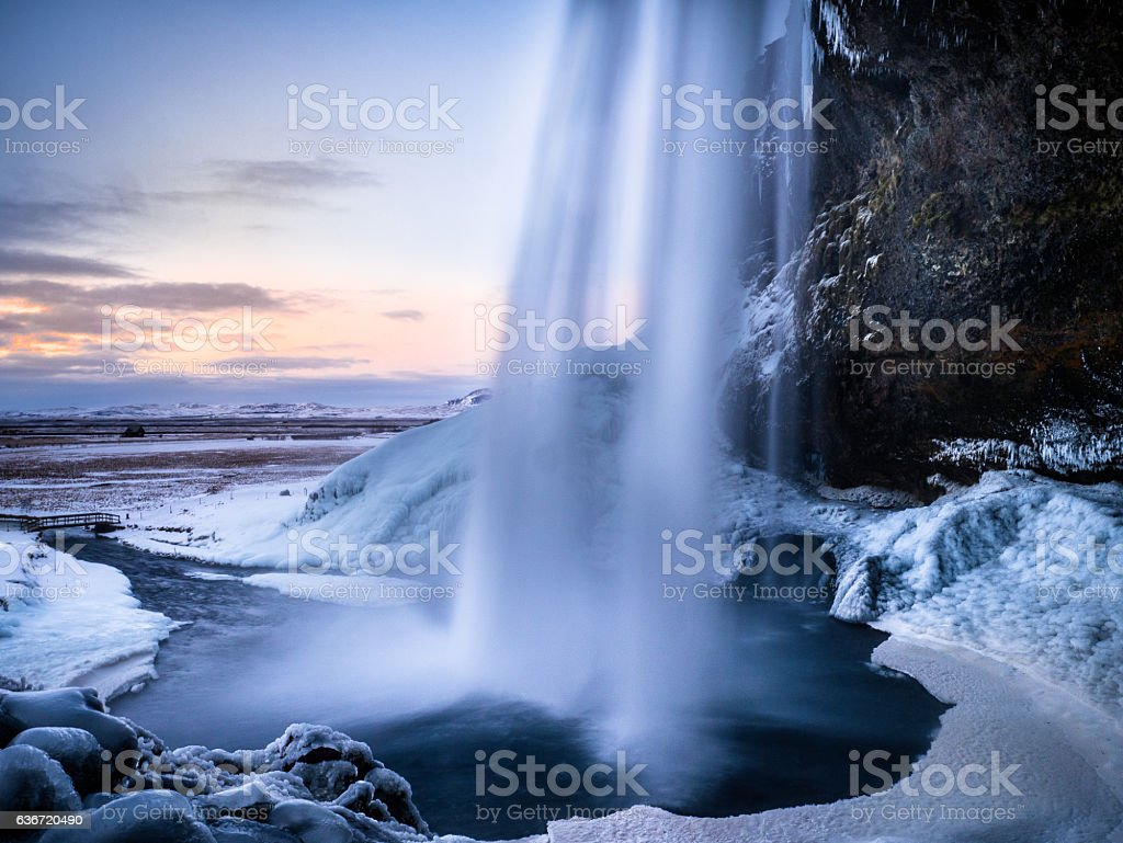 Behind the Seljalandfoss  - In the Winter of Iceland stock photo