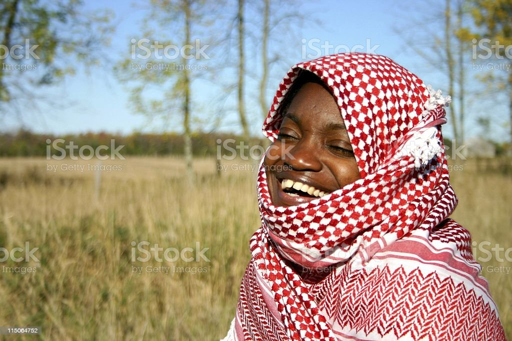behind the shawl/ laughing royalty-free stock photo