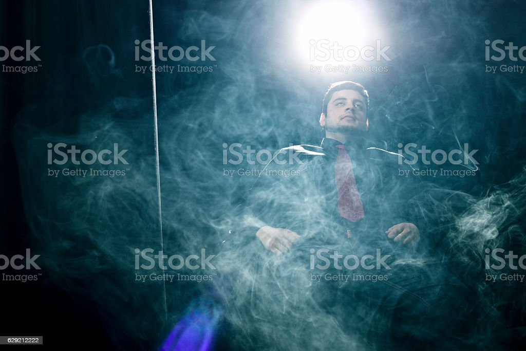 Behind the smoke stock photo