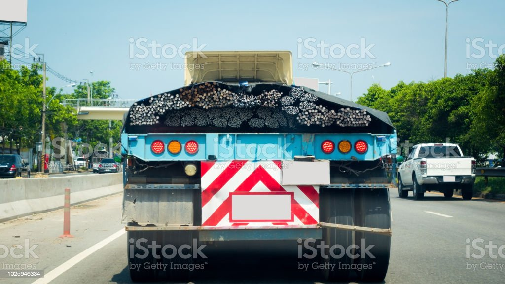 Behind The truck is running a lot of steel bars. stock photo