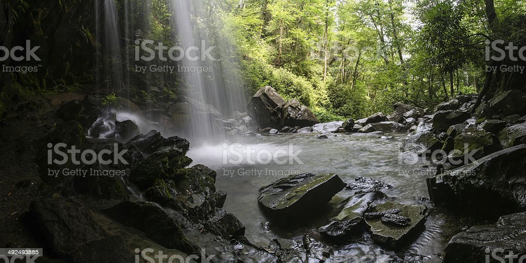 Behind the Waterfall stock photo