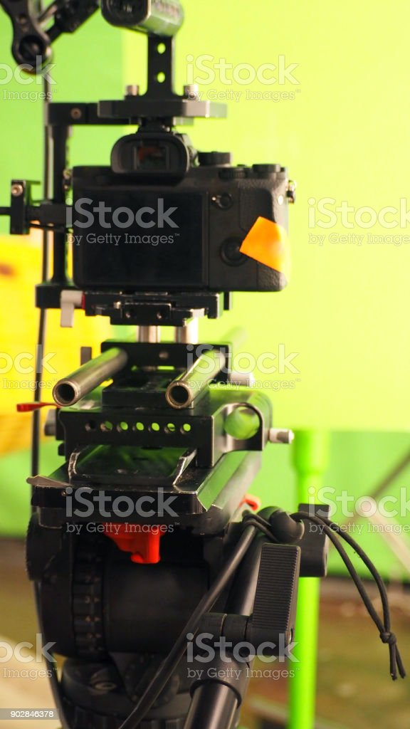Behind video camera and green screen for movie or film production stock photo