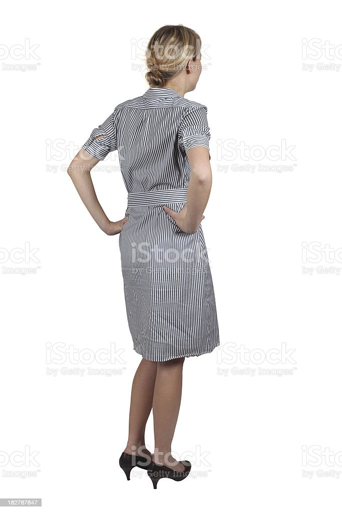 Behind view of businesswoman hands on hips stock photo