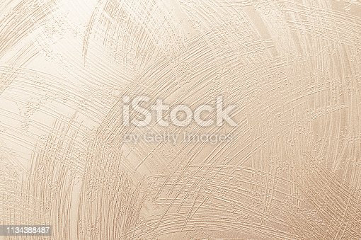 Beige abstract fabric or cream color texture background. Wallpaper of artistic wale linen canvas. Blanket or Curtain of cotton pattern with paper copy space for text decoration.