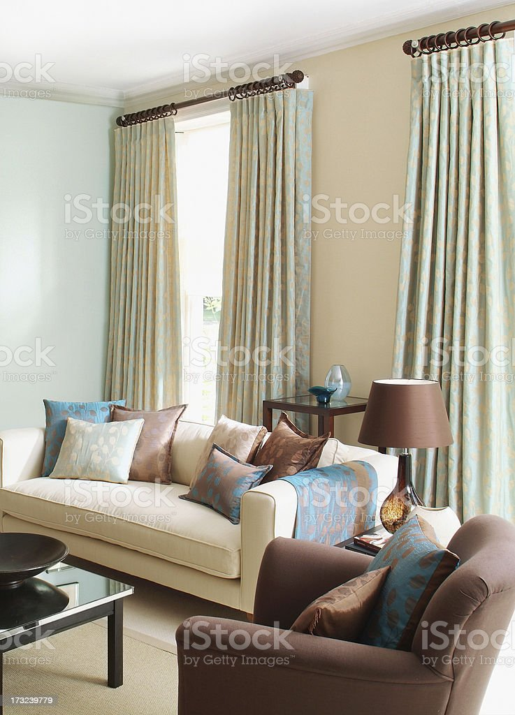 Beige and brown sofa in a living room royalty-free stock photo