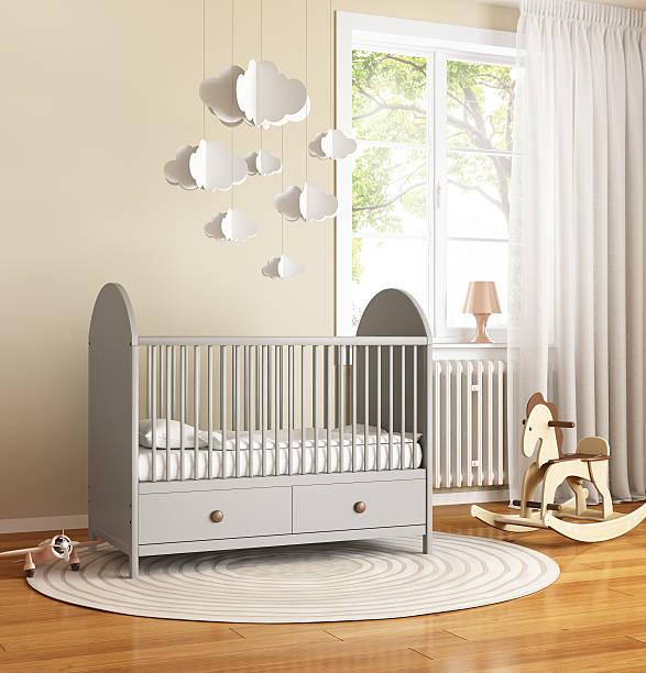Beige and grey nursery baby room with rug stock photo