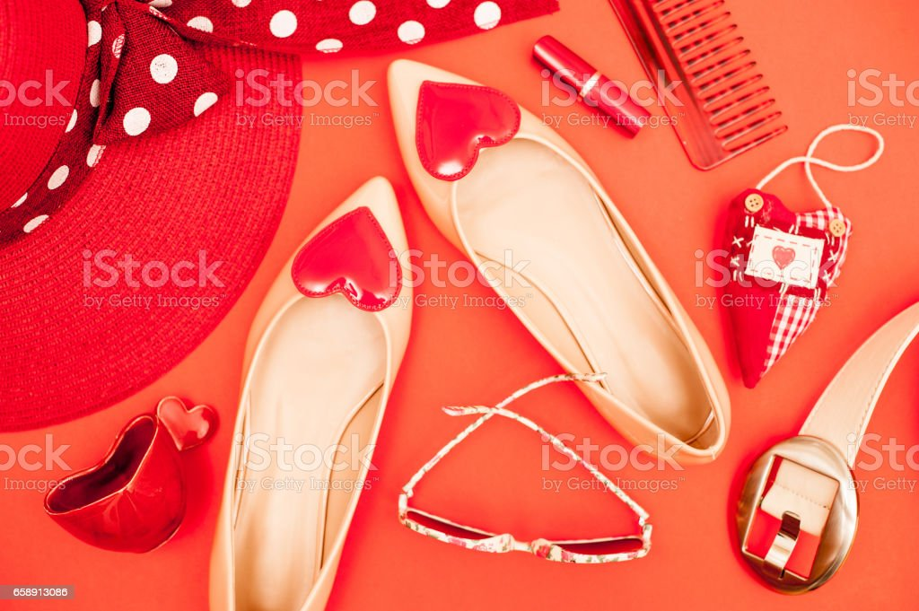 Beige And Red Personal Accessory On Orange Background - Directly Above