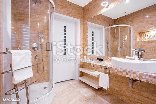 istock Beige bathroom with shower 887028060