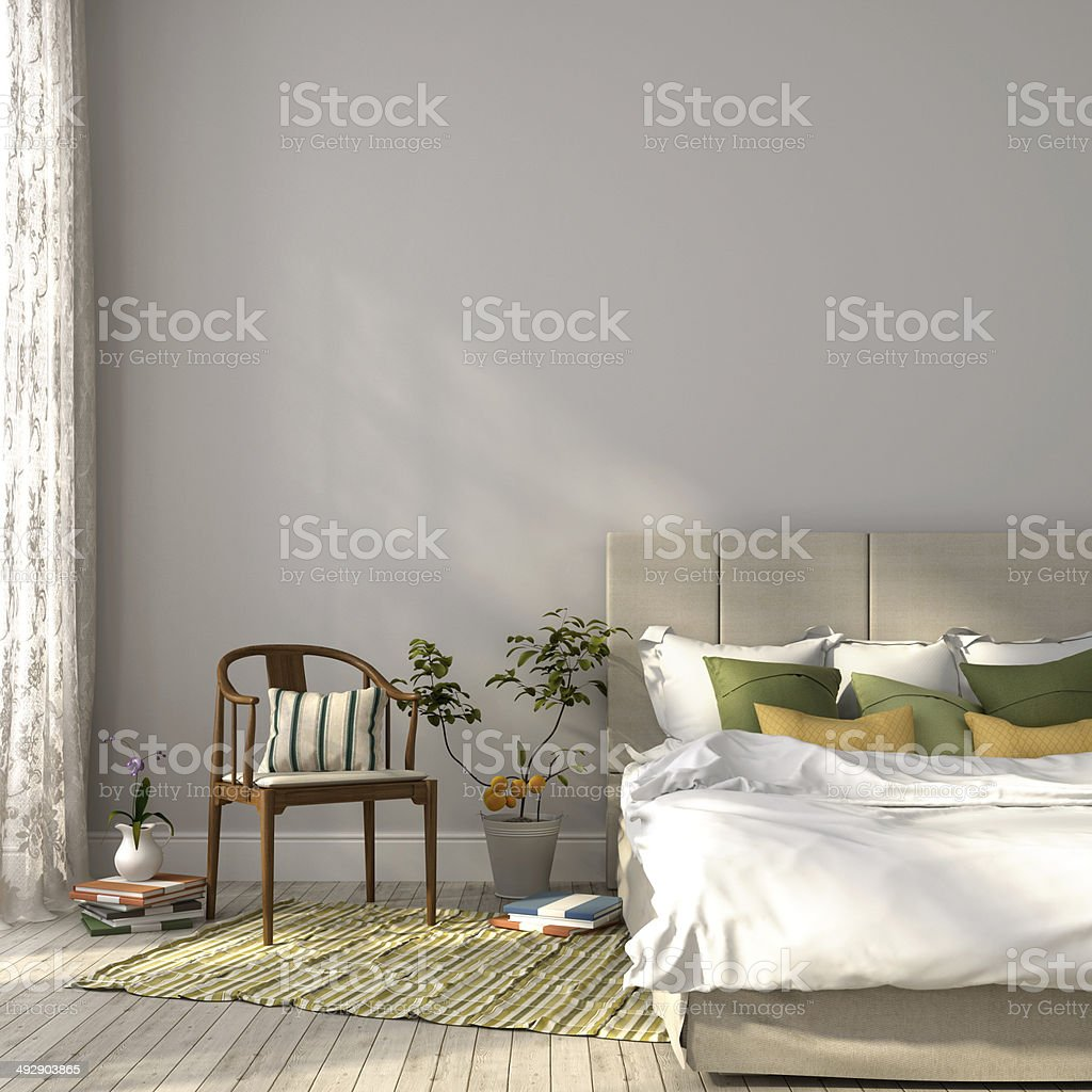 Beige bed with green decor stock photo