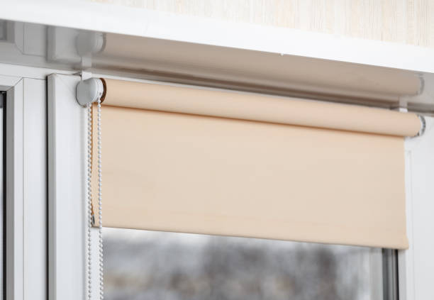 beige blackout roller blind on the window - blinds stock pictures, royalty-free photos & images