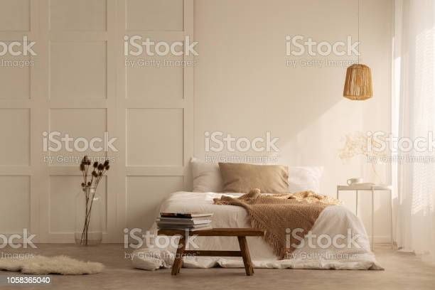 Beige blanket on the double bed in stylish wabi sabi bedroom of picture id1058365040?b=1&k=6&m=1058365040&s=612x612&h=ye md1dnpslwjly2qhwesocikefq6 o40zkzgbbmyv8=